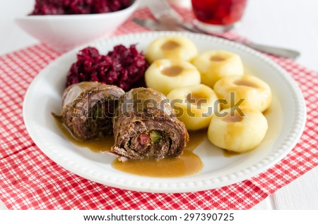 Beef rolls stuffed with bacon and pickle, potato dumplings and fried ...