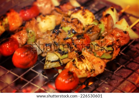 beef shish kabobs on the grill closeup - stock photo
