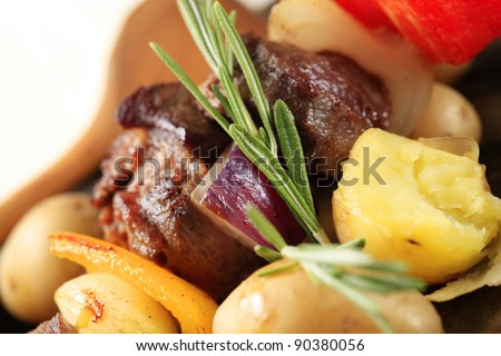 Beef shish kebab and new potatoes - stock photo