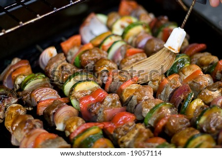 Beef shish kebabs on skewers, cooking on the grill. - stock photo