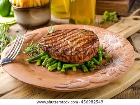 Beef sirloin steak with homemade lemonade and fazolkama - stock photo