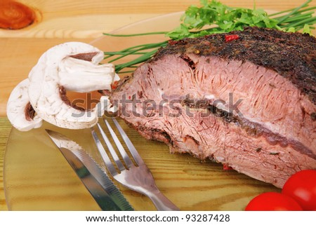 beef slice on transparent plate and vegetables on wood - stock photo