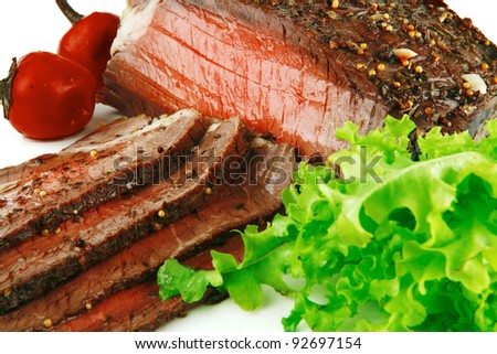beef slice with green lettuce over white