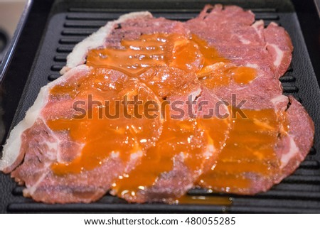 Beef slides on black dish