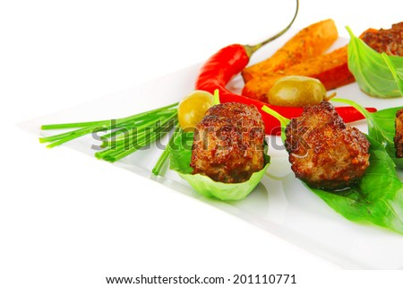 beef small cutlets with basil and hot chilli pepper - stock photo