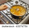 Beef Soup - fresh borscht in a pot- sitting on the stove - stock photo