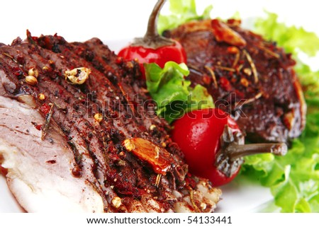 beef steak and slice on green salad over white - stock photo