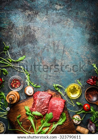 Beef steak and various ingredients for cooking on rustic wooden background, top view, frame.  Healthy, diet food concept. - stock photo
