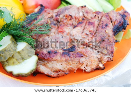 Beef steak grilled with vegetables. - stock photo