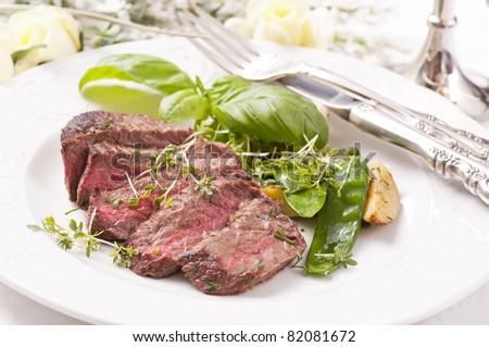 beef steak medium cut with vegetable - stock photo