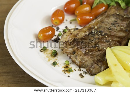 Beef steak medium grilled, on dish
