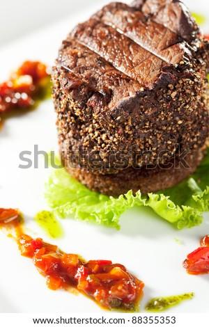 Beef Steak on Fresh Salad Leaf with Chili Sauce - stock photo