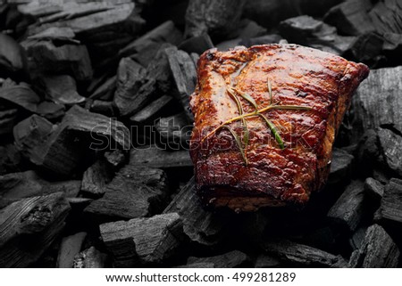 Beef steak on the charcoal. product photo, place for your advertisment