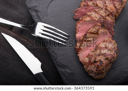 beef steak on with fresh salad on stone board background