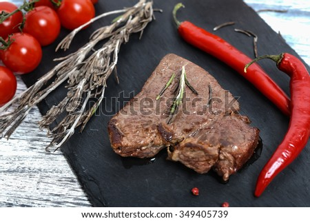 Beef steak with cherry tomatoes and chili - stock photo