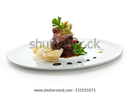 Beef Steak with Fresh Salad Leaf, Mashed Potato and Pesto Sauce - stock photo