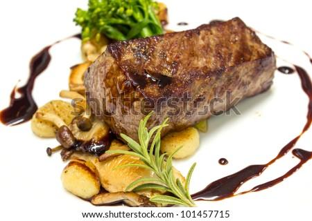 Beef steak with fried mushroom and gravy sauce - stock photo