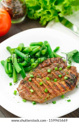 Beef steak with green beans - stock photo