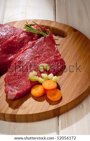 beef steak with ingredients over cutting board - stock photo