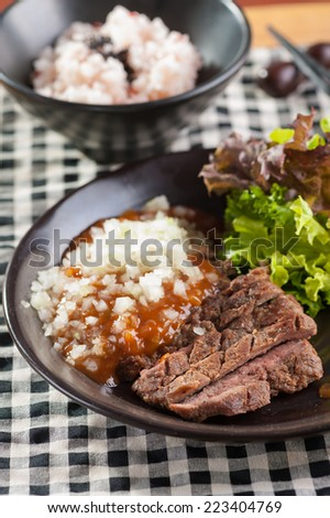 Beef steak with Japanese style sauce and rice