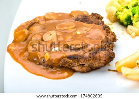 Beef steak with mushroom sauce - stock photo