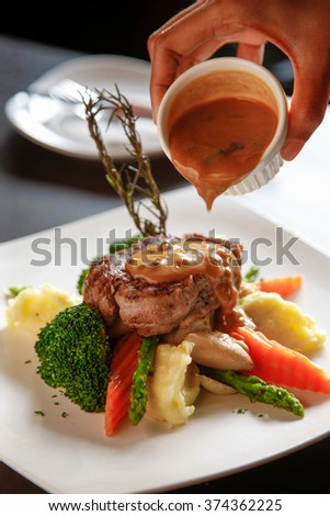 beef steak with pepper sauce and vegetable