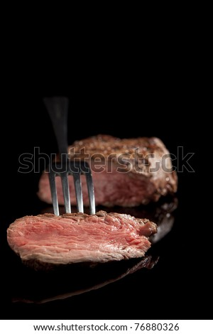 beef steak with salad and beans isolated on black background. - stock photo