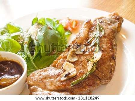 beef steak with salad on wooden table