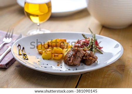 Beef Steak with some salad and a glass of beer - stock photo