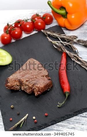 Beef steak with vegetables and thyme - stock photo
