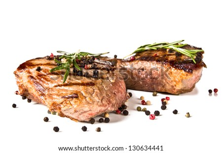 Beef steaks medium grilled, isolated on white background - stock photo
