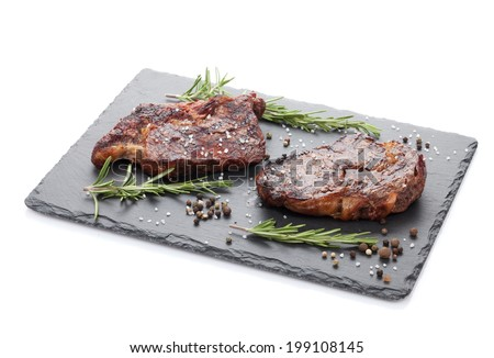 Beef steaks with rosemary and spices. Isolated on white background - stock photo