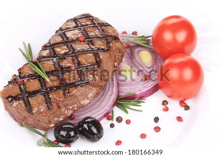 Beef steaks with rosemary and tomatoes. Isolated on a white background. - stock photo