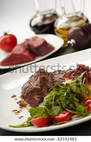 Beef steaks with vegetables - stock photo
