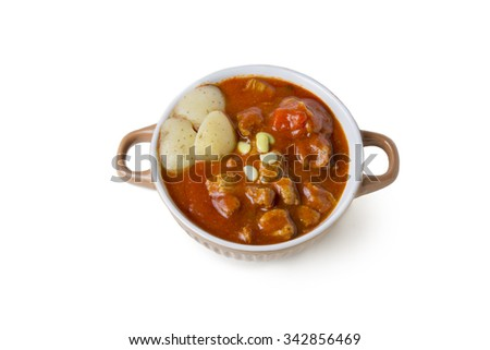 Beef stew in bowl with tomato sauce, isolated background - stock photo