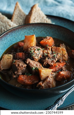 Beef Stew in turquoise bowl - stock photo