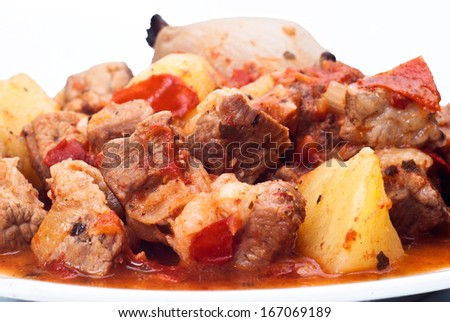 beef stew, potatoes and onion on white background - stock photo