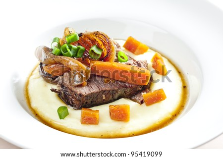 beef stew with carrot and mashed potatoes