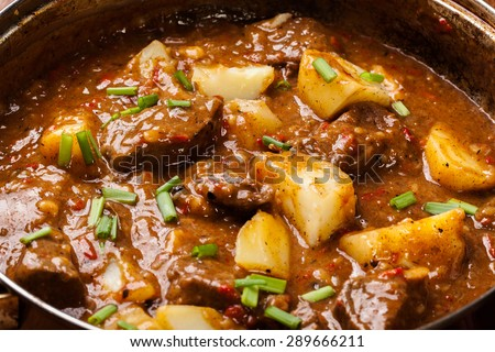 Beef stew with potatoes in a pan - stock photo
