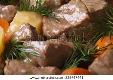 beef stew with vegetables and dill close-up. background horizontal view from the top.  - stock photo