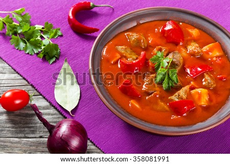 Beef stew with vegetables or goulash on the bowl, traditional hungarian meal - stock photo