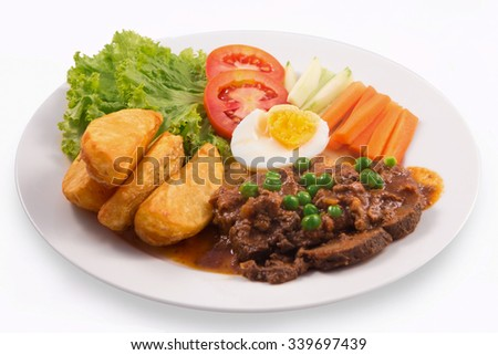 Beef stew with wedges potato, boiled eggs, cucumber, carrot, lettuce, and tomato