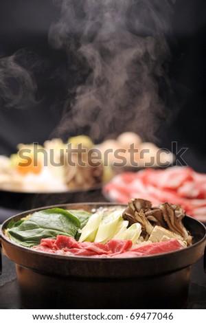 Beef Sukiyaki , Japanese Food with steam 8 - stock photo