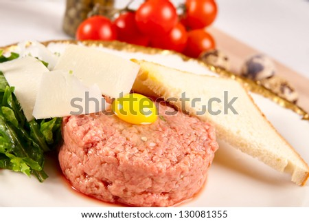 Beef tartar with parmesan cheese and small toast