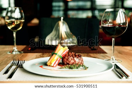 Beef, tenderloin, white wine and red wine. Vegetable bouquet and tableware.