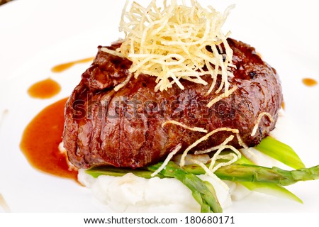Beef tenderloin with cheese - stock photo