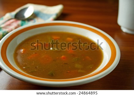 Beef vegetable soup in bowl on table - stock photo