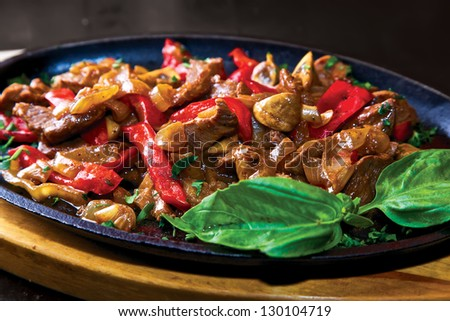 Beef with sauce. Beef, paprika, mushrooms, onion & sauce marinade - stock photo