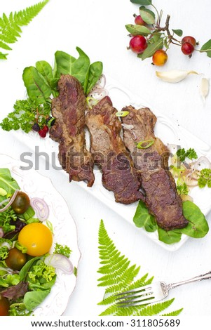 Beefsteak (angus beef, well done) with salad