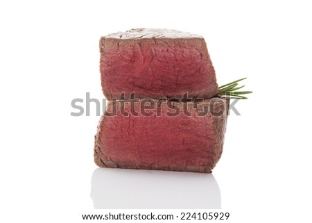 Beefsteak. Big steak with fresh herbs isolated on white background. Culinary red meat eating. - stock photo
